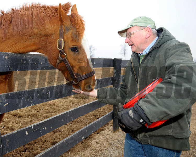 Caption: Marquetry gets a carrot from Blowen<br /> Michael Blowen and the horses at Old Friends retirement home near Georgetown, Ky. on Jan. 31, 2011.<br /> Origs2 image199<br /> Photo by Anne M. Eberhardt