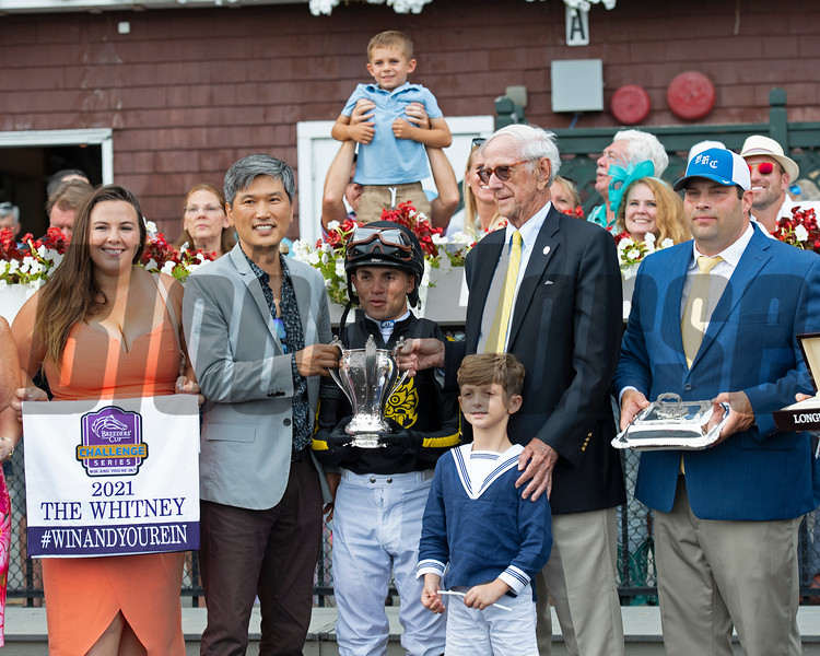 Knicks Go with Joel Rosario wins the Whitney (G1).  Presenter is Leverett Miller with his grandson Royal Douglass, owner second left, Brad Cox right<br /> Saratoga racing scenes at Saratoga in Saratoga Springs, N.Y. on Aug. 7, 2021.