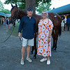 (L-R): Hip 132 colt by Bolt d'Oro out of Lotta Kim with Larry Best and Dede McGehee. <br /> Sales scenes at Fasig-Tipton in Saratoga Springs, N.Y. on Aug. 10, 2021.