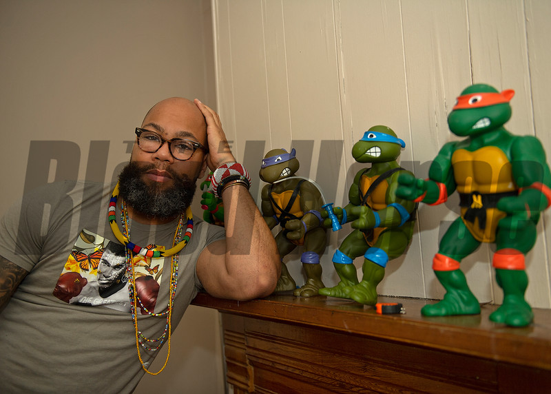 Dafri with his collectible Ninja Turtles, l-r,  Rafael (partially hidden), Donatello, Leonardo, and Michaelangelo. Dafri aka Jason Thompson, an American artist from Kentucky who specializes in multi-mediums and various subjects including a focus on black jockeys and history, in his art studio on March 2, 2021.