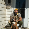 outside his studio, Dafri with his 14yo dog named Yuma James after the movie 3:10 to Yuma<br /> Dafri aka Jason Thompson, an American artist from Kentucky who specializes in multi-mediums and various subjects including a focus on black jockeys and history, in his art studio on March 2, 2021.