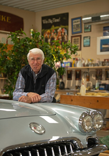 leaning on his 1960 Silver Sateen Corvette. Horsepower. John Williams at his home near Versailles, Ky. on November 18, 2020.