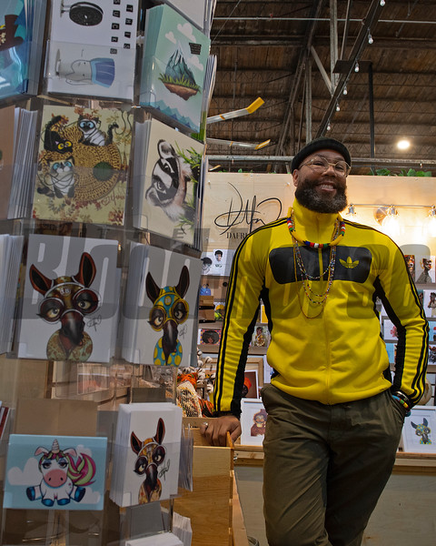 Dafris the artist in his booth at Greyline in Lexington, Ky., on March 4, 2021.