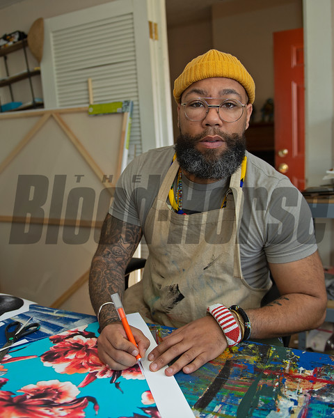 working in his studio<br /> Dafri aka Jason Thompson, an American artist from Kentucky who specializes in multi-mediums and various subjects including a focus on black jockeys and history, in his art studio on March 2, 2021.