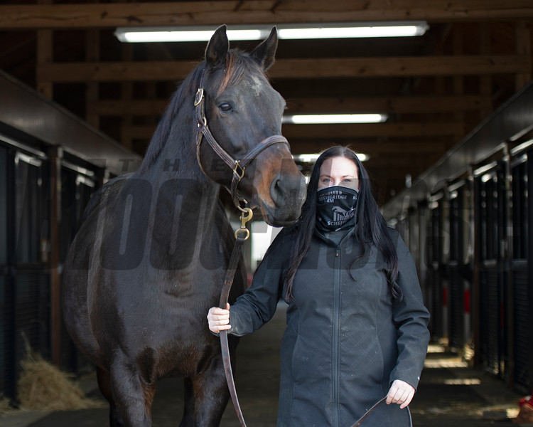 Jackie O'Rourke, Margaux broodmare manager, with the Hills' mare Solid Appeal (in foal to <br /> Twirling Candy) at Margaux near Midway, Ky., on Dec. 18, 2020.