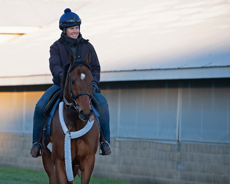 Caption: Kelly Wheeler, assistant trainer to Eddie Kenneally, on Applicator.<br /> Behind the Scenes at Keeneland during Covid19 virus and the people, horses, and essentials needed to take care of race horses on April 2, 2020 Keeneland in Lexington, KY.