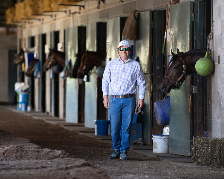 Caption: Ben Colebrook in shedrow and with horse named Scale, right.<br /> Behind the Scenes at Keeneland during Covid19 virus and the people, horses, and essentials needed to take care of race horses on April 2, 2020 Keeneland in Lexington, KY.