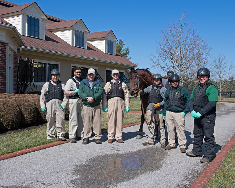Caption: about 1:54 pm, L-R: Tony Ochoa, Antonio Villalobo, John Ethington; Billy Sellers, Lemon Drop Kid, Sylvestre Morales, Asa Haley, Juan Ruelles, Les Russell. Daily Life on Billy Sellers, Lane's End Farm stallion manager who started working for the farm in 1982 and who has been their only stallion manager since 1985 when the farm acquired their first stallions, photographed on<br /> March 3, 2020 Lane's End Farm in Versailles, KY.