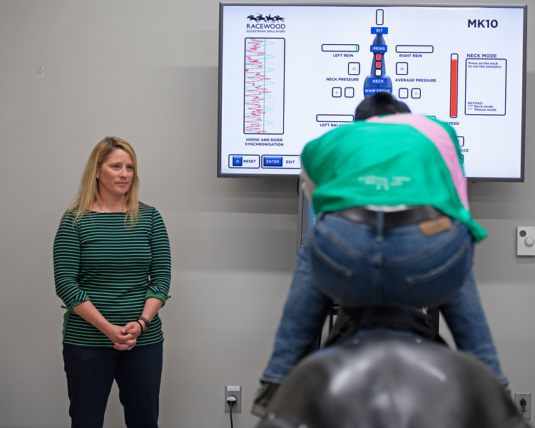 Horse and Rider Synchronisation with Director of Research JEI Kimberly Tumlin (left) and jockey Jose Ortiz on Racehorse Simulator<br /> Jockey Equestrian Initiative at University of Kentucky Sports Medicine Research Institute<br />  on April 11, 2019 in Lexington, Ky.