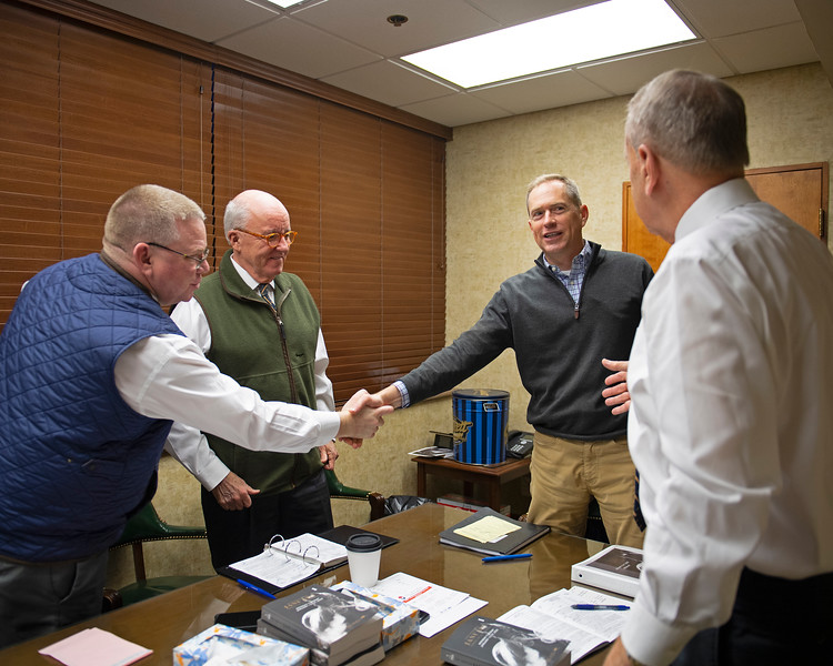 (L-R): Kurt Becker and Ryan Mahan with consignor Joe Seitz and announcer John Henderson after discussing Seitz' consignment<br /> Keeneland January Horses of all ages sales on<br /> Jan. 14, 2020 Keeneland in Lexington, KY.