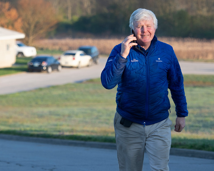 Caption:trainer  Johnny Burke (on phone with trainer Eoin Harty)<br /> Behind the Scenes at Keeneland during Covid19 virus and the people, horses, and essentials needed to take care of race horses on April 2, 2020 Keeneland in Lexington, KY.