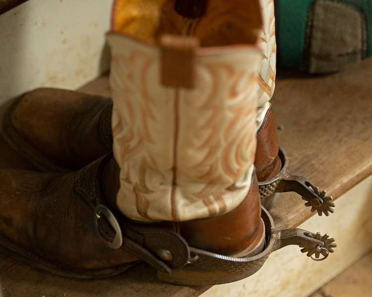 Caption: Heath's boots and spurs<br /> A native of Oklahoma, Heath started working at WinStar Farm on October 10, 2014, and became the farm trainer in October of 2018. Presently he has about 100 horses in training at the WinStar Farm training center, where they have a 7 1/2-furlong main track and 3/4 of a mile undulating turf gallop.<br /> Daily Life series on Destin Heath, farm trainer at WinStar Farm on Aug. 11, 2020 WinStar Farm in Versailles, KY.