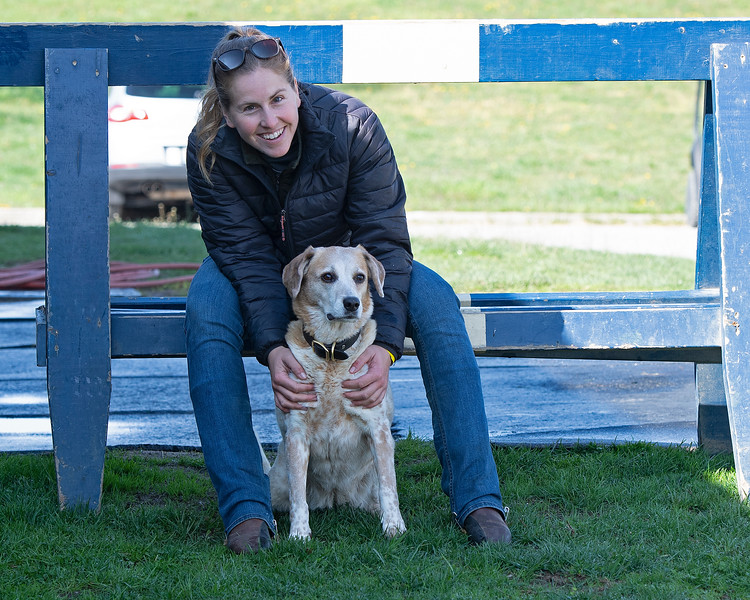 Caption: Kelly Wheeler, exercise rider and assistant trainer to Eddie Kenneally outside of Rice Road barn with her dog Dixie.<br /> Behind the Scenes at Keeneland during Covid19 virus and the people, horses, and essentials needed to take care of race horses on April 2, 2020 Keeneland in Lexington, KY.
