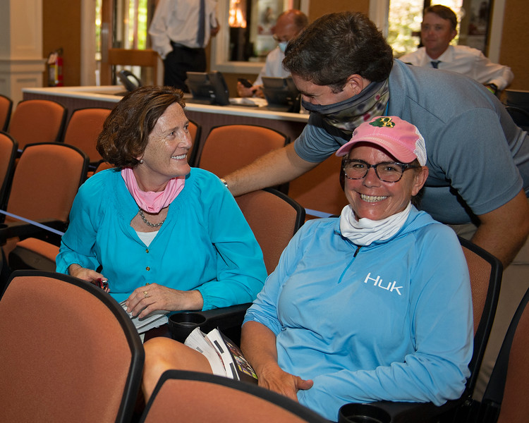 Buyer Marette Farrell (left) gets congratulated by Conrad Bandoroff. Tescha Von Bluecher (part of Marrette's team with Zoe Cadman not pictured). Hip 400 colt by American Pharaoh out of Swingit from Denali<br /> Fasig-Tipton Selected Yearlings Showcase in Lexington, KY on September 10, 2020.