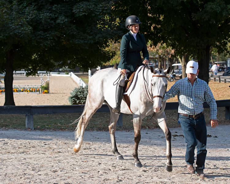 Ollie Figgins III leads #48 Blazin Luck with his daughter Emilie Figgins before her class<br /> Thoroughbred Makeover at the Kentucky Horse Park.
