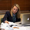 Gabby Gaudet researching updates before announcing on. the Keeneland auction stand.<br /> Keeneland January Horses of all ages sales on<br /> Jan. 15, 2020 Keeneland in Lexington, KY.