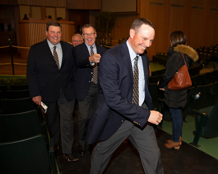 (Front Jesse Bolin, with l-r, Mitchell Armitage and Roger Spencer) Enjoying. a moment after the conclusion of the first session of the Keeneland January sales on<br /> Jan. 13, 2020 Keeneland in Lexington, KY.