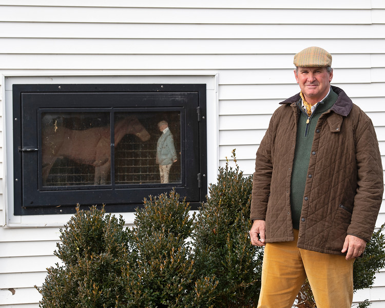James Keogh outside his barn at Grovendale on Dec. 14, 2019 Grovendale in Versailles, Ky., with metal sculpture of James and horse at sales.