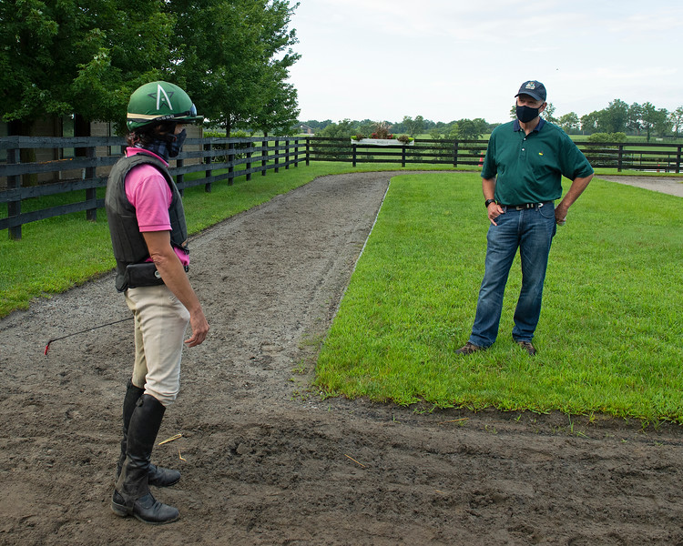 Caption: (L-R): exercise rider Michael Heath talks with Reynolds Bell after he watched horses work. <br /> A native of Oklahoma, Heath started working at WinStar Farm on October 10, 2014, and became the farm trainer in October of 2018. Presently he has about 100 horses in training at the WinStar Farm training center, where they have a 7 1/2-furlong main track and 3/4 of a mile undulating turf gallop.<br /> Daily Life series on Destin Heath, farm trainer at WinStar Farm on Aug. 11, 2020 WinStar Farm in Versailles, KY.