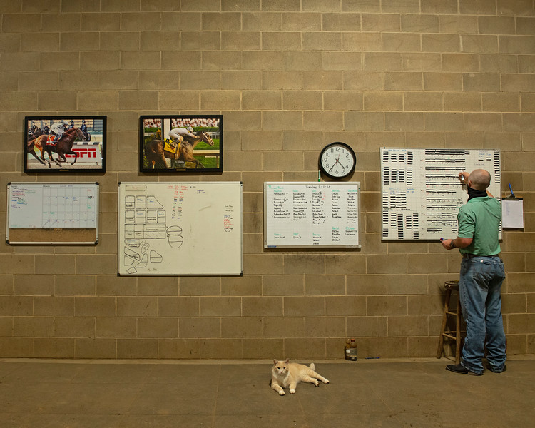 Caption: updating set lists as Leo the Cat relaxes. Leo has his own IG page. <br /> A native of Oklahoma, Heath started working at WinStar Farm on October 10, 2014, and became the farm trainer in October of 2018. Presently he has about 100 horses in training at the WinStar Farm training center, where they have a 7 1/2-furlong main track and 3/4 of a mile undulating turf gallop.<br /> Daily Life series on Destin Heath, farm trainer at WinStar Farm on Aug. 11, 2020 WinStar Farm in Versailles, KY.