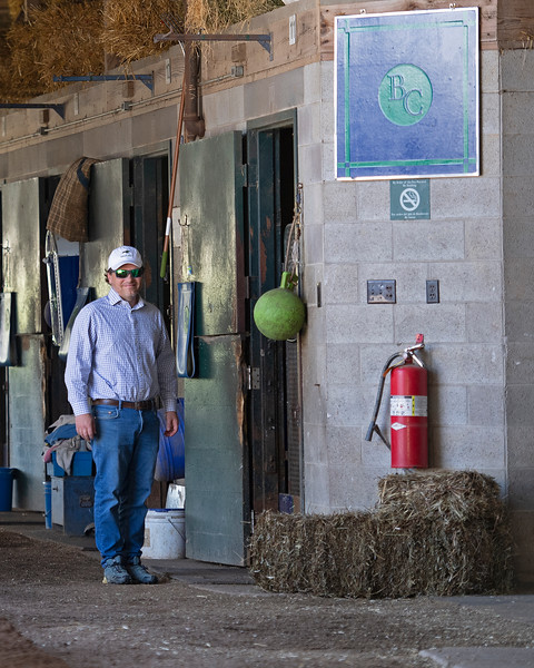 Caption: Ben Colebrook in shedrow and with horse named Scale<br /> Behind the Scenes at Keeneland during Covid19 virus and the people, horses, and essentials needed to take care of race horses on April 2, 2020 Keeneland in Lexington, KY.
