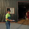 Caption: Drury barn scene as barn cat walks to barn and exercise rider prepare for next set as Drury looks on. <br /> Bruce Lunsford at Skylight Training Center with his horse Art Collector and trainer Tommy Drury on Aug. 12, 2020 Skylight Training Center in Prospect, KY.