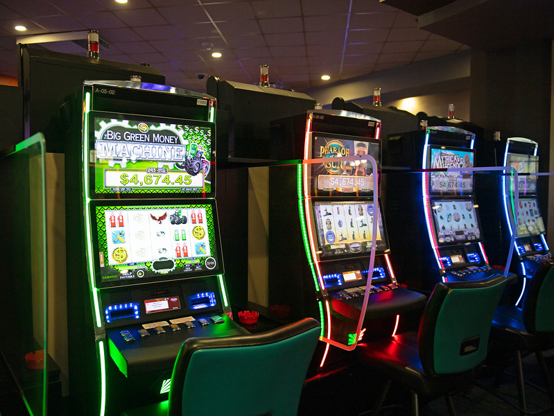 Caption: slot machines with plexiglass partitions<br /> Ted Nicholson, general manager and senior Vice President at Kentucky Dpwns near Franklin, Ky. on July 28, 2020 Kentucky Downs in Franklin, KY.