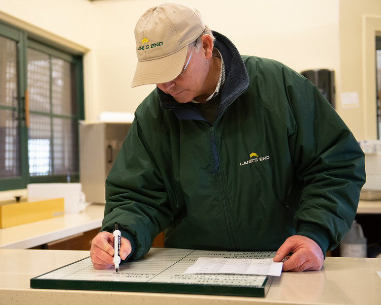 Caption: about 1:58  pm, Billy prints breeding shed list of mares and adds to stallion board. Daily Life on Billy Sellers, Lane's End Farm stallion manager who started working for the farm in 1982 and who has been their only stallion manager since 1985 when the farm acquired their first stallions, photographed on<br /> March 3, 2020 Lane's End Farm in Versailles, KY.