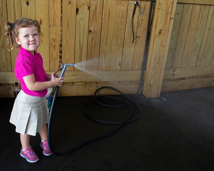 Caption: Charlotte O'Meara, 3, helps with the hose and filling buckets and occasionally sprays humans.<br /> Aidan and Leah O'Meara at Stonehaven Steadings near Versailles, Ky. on Aug. 7, 2020 Stonehaven Steadings in Versailles, KY.