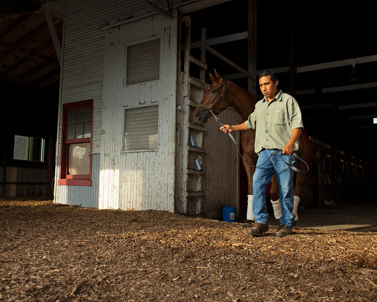 Caption:  Barn foreman Jose Garcia leads Art Collector out of the barn.<br /> Bruce Lunsford at Skylight Training Center with his horse Art Collector and trainer Tommy Drury on Aug. 12, 2020 Skylight Training Center in Prospect, KY.