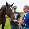Caption:  with Connor Burton, holding mare, and his father Tony Burton, on right.<br /> Hollywood Story at Starwood Farm near Versailles, Ky., on June 30, 2020 Starwood Farm in Versailles, KY.