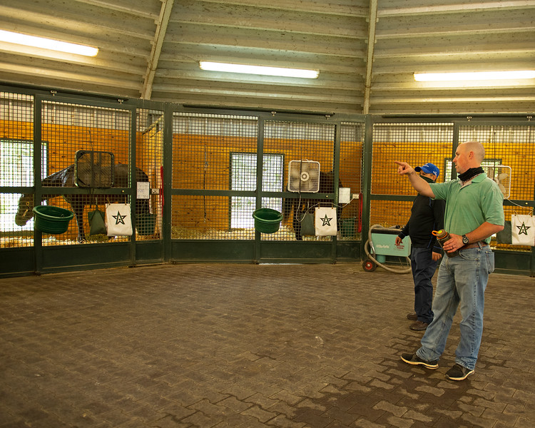 Caption: Destin goes to lower barn for a walk around to check on all the horses. He works and chats  about the horses with Celso Barragan.<br /> A native of Oklahoma, Heath started working at WinStar Farm on October 10, 2014, and became the farm trainer in October of 2018. Presently he has about 100 horses in training at the WinStar Farm training center, where they have a 7 1/2-furlong main track and 3/4 of a mile undulating turf gallop.<br /> Daily Life series on Destin Heath, farm trainer at WinStar Farm on Aug. 11, 2020 WinStar Farm in Versailles, KY.