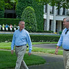 Caption: (L-R): Thomason and Fleming  talking and walking in the saddling area<br /> Drew Fleming with Bill Thomason at Keeneland in Lexington, Ky., on June 19, 2020 Keeneland in Lexington, KY.