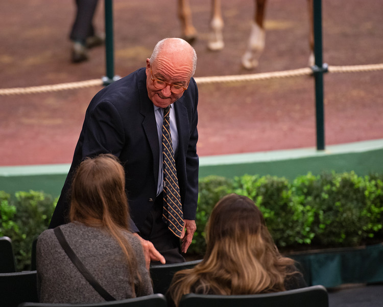 Ryan Mahan talks with buyers as he finishes his shift and heads to the sales meeting room.<br /> Keeneland January Horses of all ages sales on<br /> Jan. 15, 2020 Keeneland in Lexington, KY.