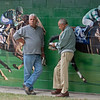 Scene at Lane's End as two men lean against Lane's End mural with Noble Mission, left, and The Factor<br /> at the Keeneland September Sale.