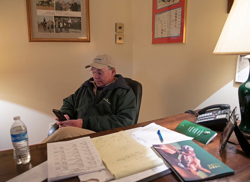 Caption: about 4 pm, in his office checking messages and emails. Daily Life on Billy Sellers, Lane's End Farm stallion manager who started working for the farm in 1982 and who has been their only stallion manager since 1985 when the farm acquired their first stallions, photographed on<br /> March 3, 2020 Lane's End Farm in Versailles, KY.