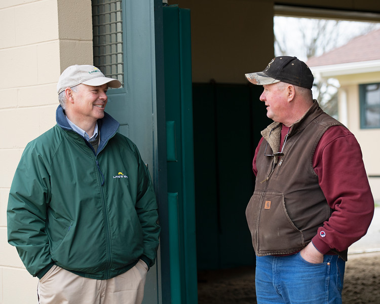 Caption: about 1:55  pm, Billy greets Ron Patterson with mare 2 in the afternoon session before going to the lab to run printouts/update stallion board. . Daily Life on Billy Sellers, Lane's End Farm stallion manager who started working for the farm in 1982 and who has been their only stallion manager since 1985 when the farm acquired their first stallions, photographed on<br /> March 3, 2020 Lane's End Farm in Versailles, KY.