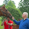 Caption: Searing with mare Christina<br /> Lee and Susan Searing look over their bloodstock (mares, foals, yearlings) at Springhouse Farm near Nicholasville, Ky., on June 22, 2020 Springhouse Farm in Nicholasville, KY.