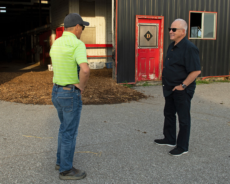 Caption: Lunsford, right, talking with Drury outside the Drury barn.<br /> Bruce Lunsford at Skylight Training Center with his horse Art Collector and trainer Tommy Drury on Aug. 12, 2020 Skylight Training Center in Prospect, KY.