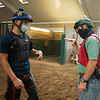 Caption: (L-R): exercise rider Alturo Quintaros and Destin discuss riding a horse between sets at 7:25 am<br /> A native of Oklahoma, Heath started working at WinStar Farm on October 10, 2014, and became the farm trainer in October of 2018. Presently he has about 100 horses in training at the WinStar Farm training center, where they have a 7 1/2-furlong main track and 3/4 of a mile undulating turf gallop.<br /> Daily Life series on Destin Heath, farm trainer at WinStar Farm on Aug. 11, 2020 WinStar Farm in Versailles, KY.