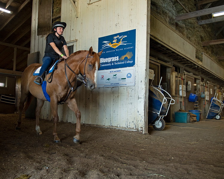 Caption: student Chelsea Pizzuto rides in the barn<br /> BCTC equine school and NARA in Lexington, Ky., and Thoroughbred Training Center, on July 6, 2020 BCTC in Lexington, KY.