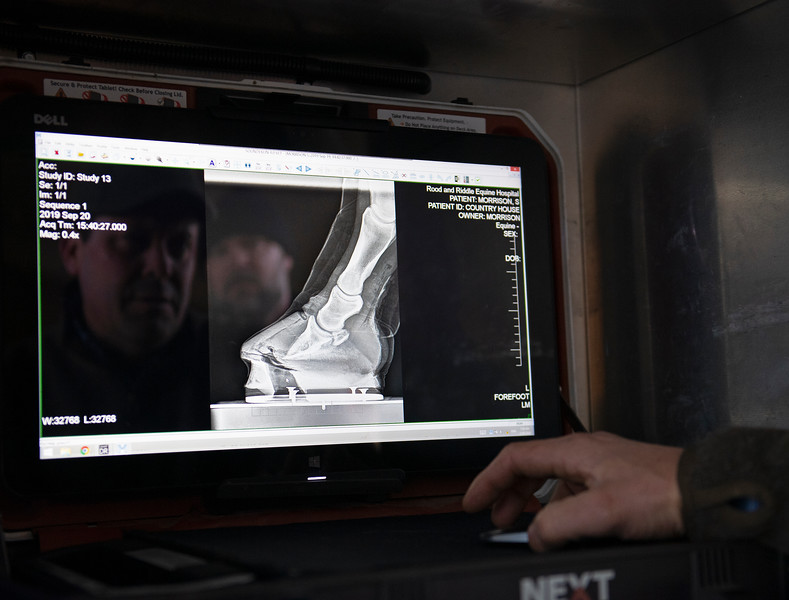 Country House radiograph xray from September 20, 2019, is reviewed by Scott Morrison DVM (left in reflection) and Guiness McFadden at Blackwood Stables on<br /> Feb. 28, 2020 Blackwood Stables in Versailles, KY.