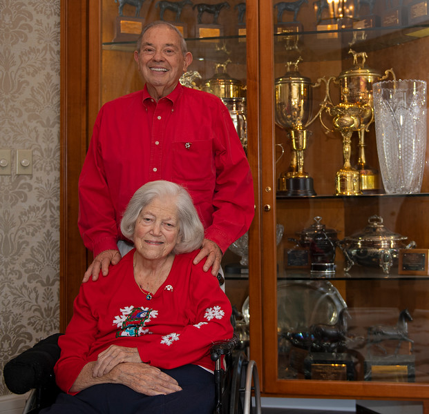 Sarah and Ken Ramsey in front of trophy case at their home on Ramsey Farm, Dec. 23, 2019.