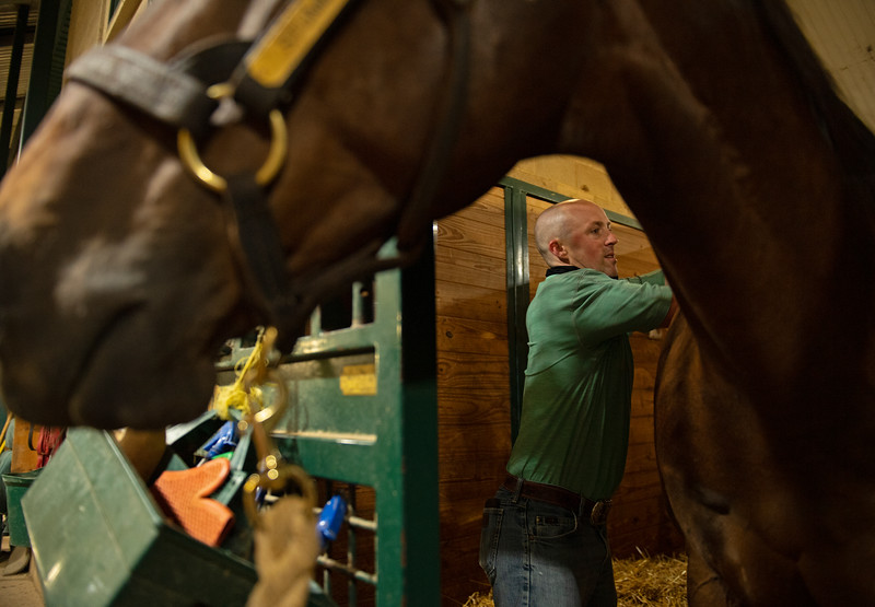 Caption: Grooming Stumbles, his Thoroughbred pony. <br /> A native of Oklahoma, Heath started working at WinStar Farm on October 10, 2014, and became the farm trainer in October of 2018. Presently he has about 100 horses in training at the WinStar Farm training center, where they have a 7 1/2-furlong main track and 3/4 of a mile undulating turf gallop.<br /> Daily Life series on Destin Heath, farm trainer at WinStar Farm on Aug. 11, 2020 WinStar Farm in Versailles, KY.