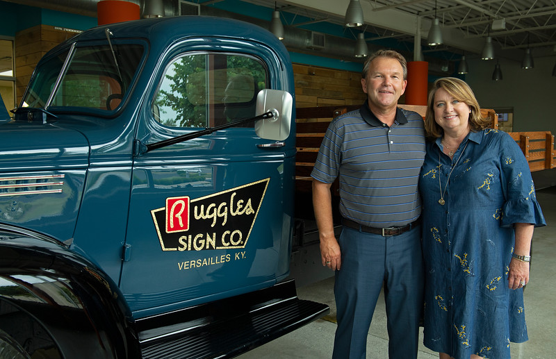 Caption: (L-R): Tim and Anna Cambron with restored truck from company built in 1946<br /> Tim and Anna Cambron at Ruggles sign company in Versailles, Ky. on July 8, 2020 Ruggles in Versailles, KY.
