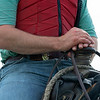 Caption: Heath's hands on the saddle horn<br /> A native of Oklahoma, Heath started working at WinStar Farm on October 10, 2014, and became the farm trainer in October of 2018. Presently he has about 100 horses in training at the WinStar Farm training center, where they have a 7 1/2-furlong main track and 3/4 of a mile undulating turf gallop.<br /> Daily Life series on Destin Heath, farm trainer at WinStar Farm on Aug. 11, 2020 WinStar Farm in Versailles, KY.