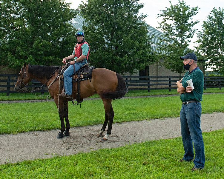 Caption: (L-R): Destin Heath on Fred talks with Reynolds Bell after he watched horses train and return to the walking area in the training barn complex. <br /> A native of Oklahoma, Heath started working at WinStar Farm on October 10, 2014, and became the farm trainer in October of 2018. Presently he has about 100 horses in training at the WinStar Farm training center, where they have a 7 1/2-furlong main track and 3/4 of a mile undulating turf gallop.<br /> Daily Life series on Destin Heath, farm trainer at WinStar Farm on Aug. 11, 2020 WinStar Farm in Versailles, KY.
