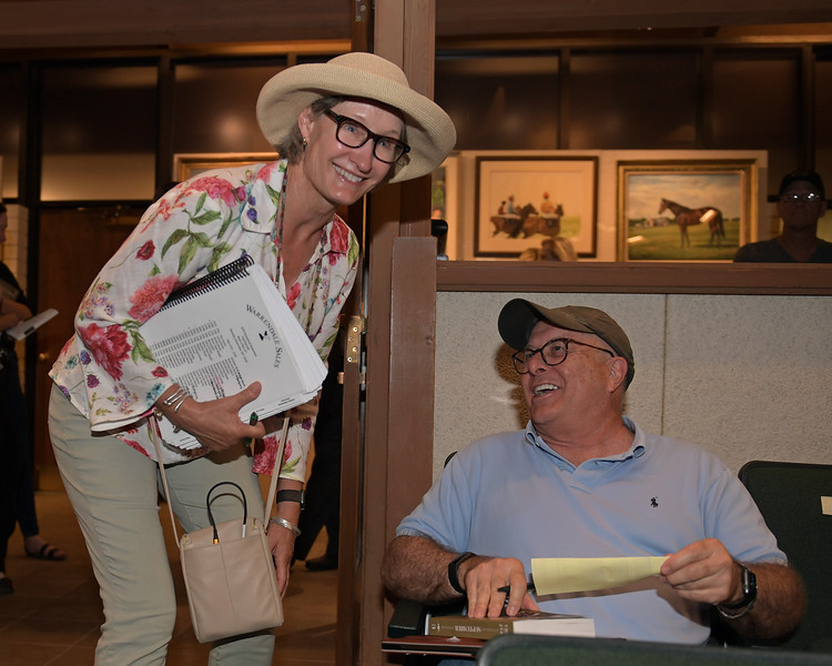 Consignor Kitty Taylor, left, with buyer David Fiske for HIp 1941<br /> at Keeneland.