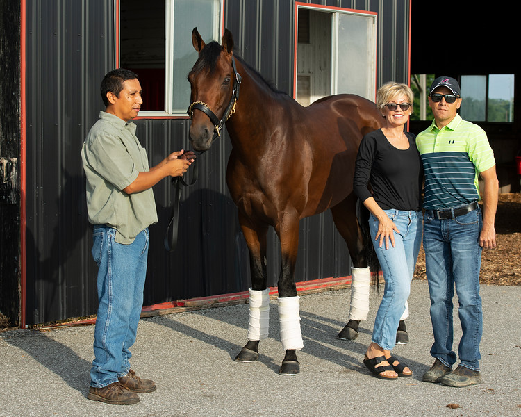 Caption: (L-R): Jose Garcia holding Art Collector with Eleanor Porco and Tommy Drury Jr. <br /> Bruce Lunsford at Skylight Training Center with his horse Art Collector and trainer Tommy Drury on Aug. 12, 2020 Skylight Training Center in Prospect, KY.