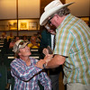 Gatewood Bell (left) gets congratulated after buying Hip 3147<br /> at Keeneland September sale.